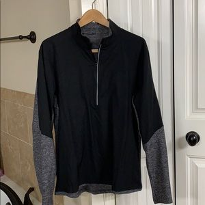 Never worn Lulu Lemon black/gray workout pullover.